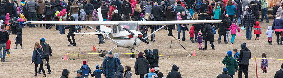 Large crowd around an airplane at an Oshawa Executive Airport event.