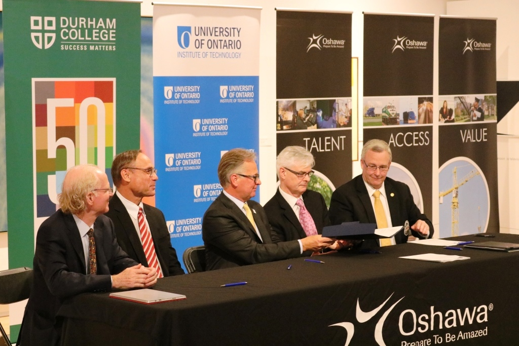 Signing of the Memorandum of Understanding by Peter Halsall, Brent Sleep, Don Lovisa, Tim McTiernan, Mayor John Henry