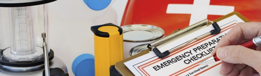 emergency checklist on a clipboard and supplies