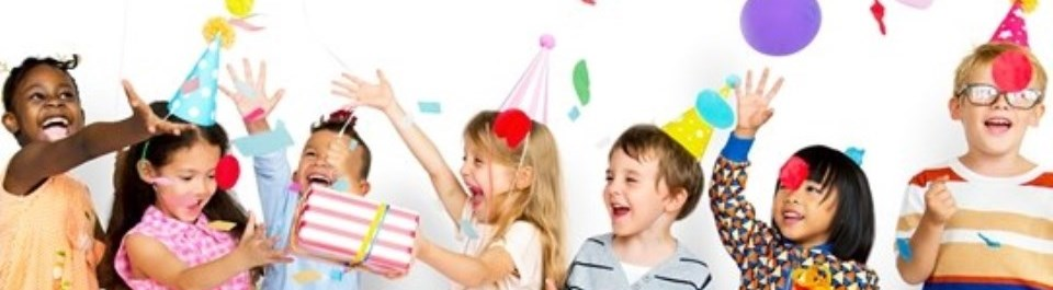 Children laughing celebrating a birthday