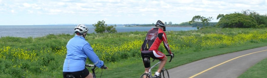 Cyclists riding bikes on the Waterfront Trail