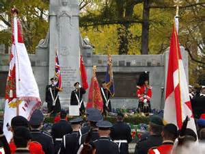 Remembrance Day Ceremony at the cenotaph in Memorial Park with soldiers and flags